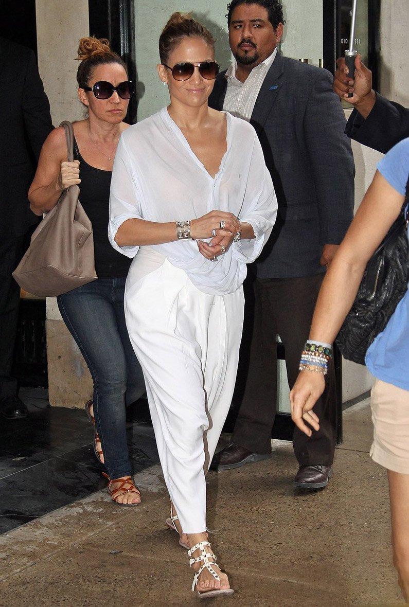 Jennifer Lopez out with friends shopping at Barney's then afterwards goes out to lunch at Nello's in New York City.